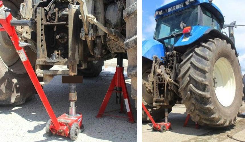 Anheben des Traktors mit einem Wagenheber und Aufbocken auf Unterstellböcken